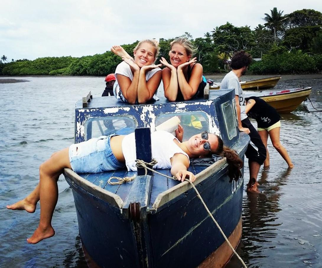 Projects Abroad volunteers relax on a boat during their free time in Fiji.